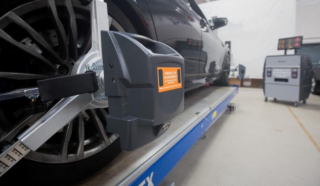 Absolute Alignment Bluetooth Pro wheel alignment equipment in use