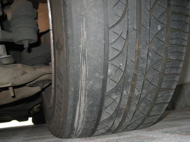Tyre badly worn by incorrect alignment